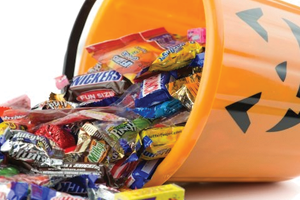 Bucket of halloween candy that can cause cavities