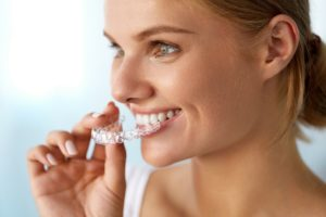Patient at Cobblestone Park Family Dentistry using invisalign to straighten her teeth